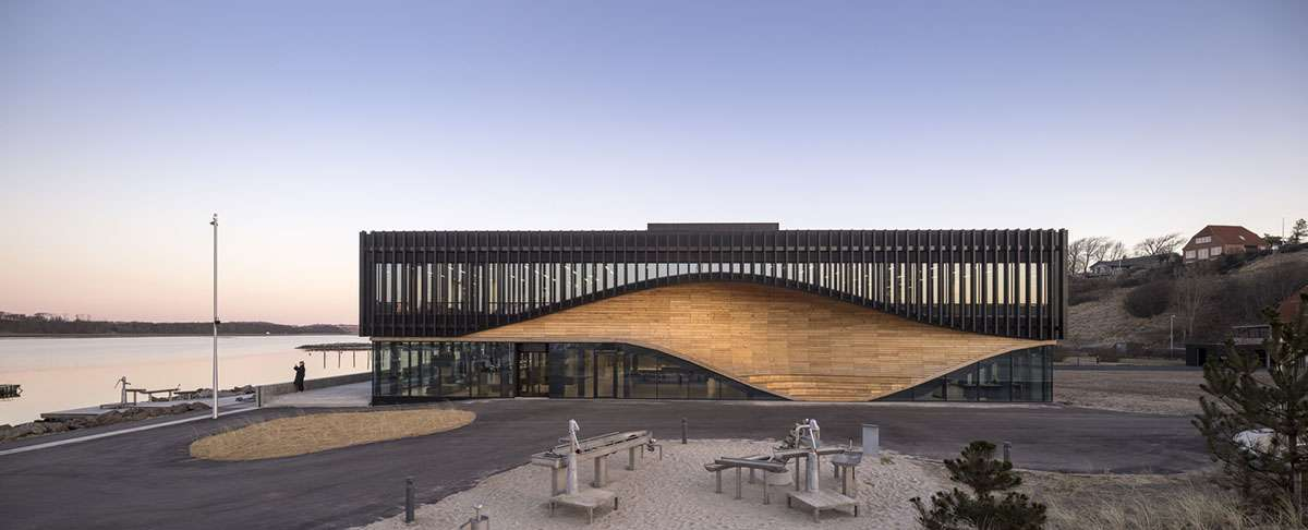 A wooden wave climatium in Denmark to be completed by 3XN Architects and SLA Architects