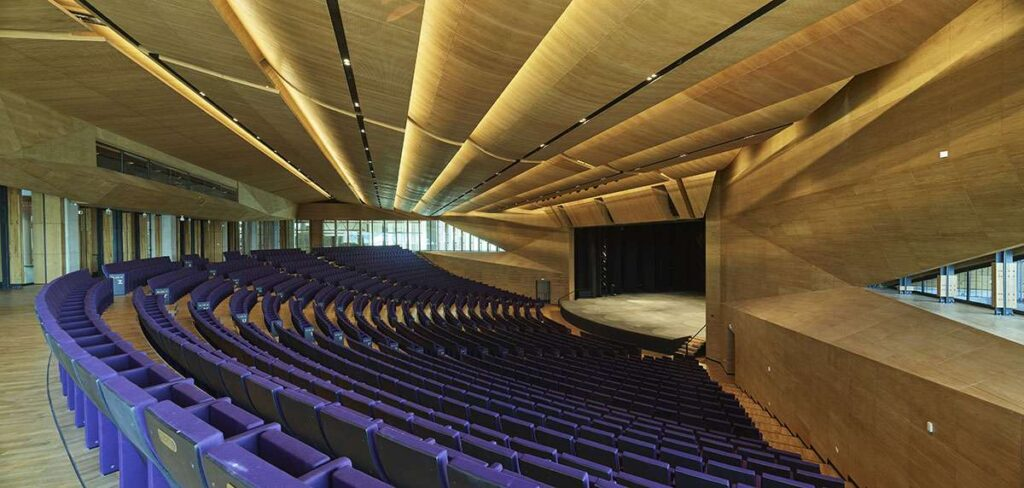 The design of the facade of the performing arts center with triangular wooden surfaces